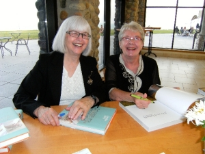 Signing our books at the Meet and Greet Pary, June 24th